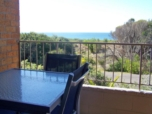 STUNNING APARTMENT OVERLOOKING THE PACIFIC OCEAN. Luxurious spacious 2 brm top floor corner apartment with lounge & dining area is in a unique position overlooking the Ocean & bushland reserve.  Airco...