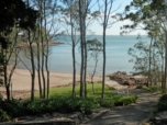 LAWNS TO BEACHFRONT.  Fantastic position in North Arm Cove with stunning views and direct access to the beachfront.  The Air conditioned residence comprises of three large bedrooms, main with ensuite,...   Click for More Info